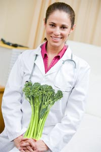 Doctor Holding Broccoli in Office